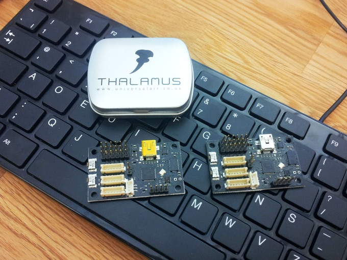 Two Thalamus boards, and limited edition tin, with keyboard for scale