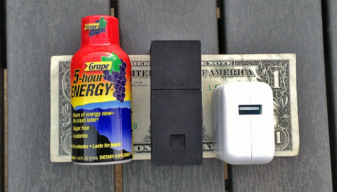 Here's a quick comparison shot with an energy shot, an iPad charger, and a dollar bill.