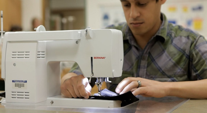 Trent working on sweat-proof sleeve