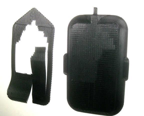 """Early version of a HOG case 3D printed by a home user; the """"raft"""" on the left made it an easy decision to not use rafts again. Also note the ridges in the 3D printed air tube at the top-right; these are being replaced with injection aquarium fittings"""