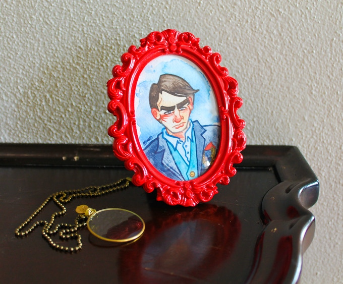Small framed original artwork and monocle necklace