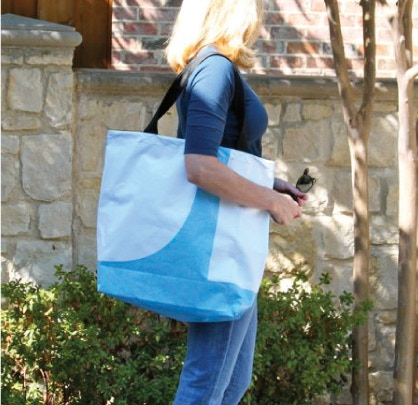 Shopping Totes Made Out of Old Billboard Vinyl with a UA Stiched Tag