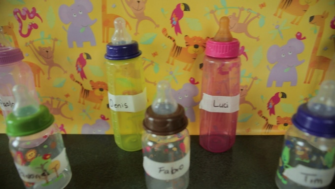 The baby bottles at my son's daycare were all missing their lids.