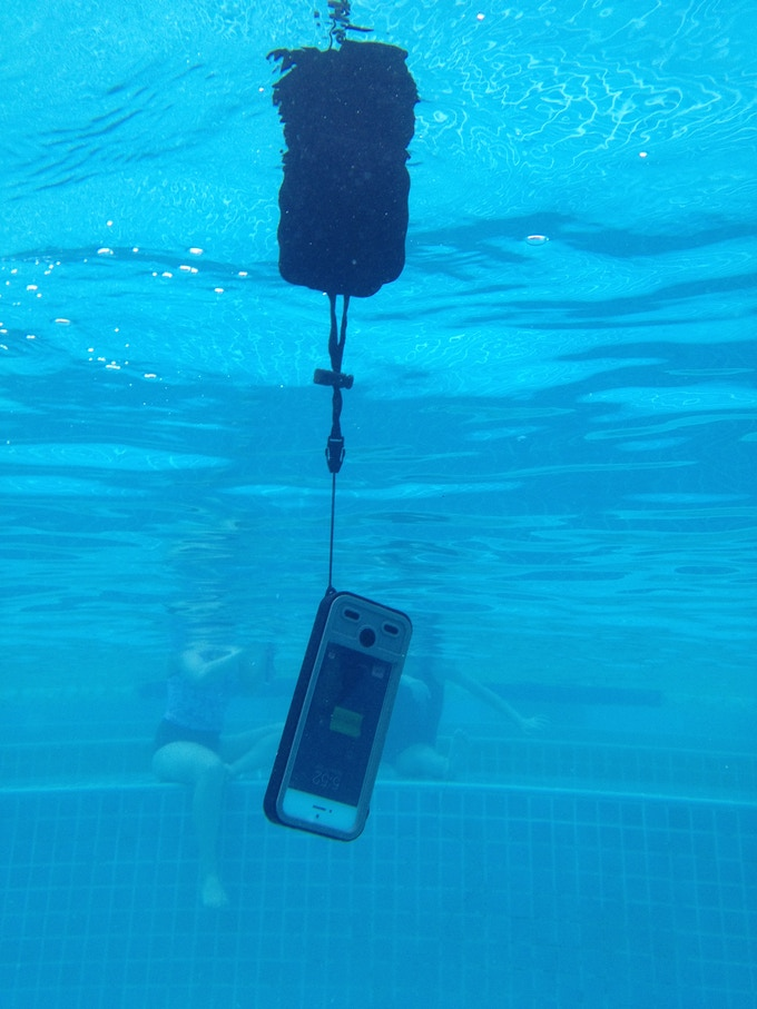 Mojo Refuel Aqua charging in pool suspended by floatation hand sling