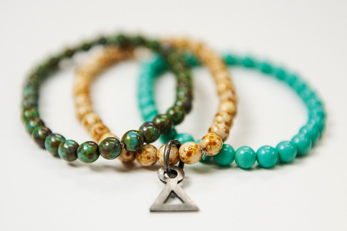 (Comes in pack of 3) Absidee Hand Made 6mm Green/Cream/Teal Glass Bead Bracelets w/ Custom laser cut charms from Santa Barbara, CA