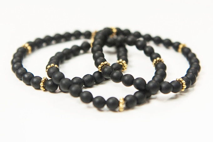 (Comes in Pack of 3 ) Absidee Hand Made 6mm Matte-Black Glass Bead Bracelets w/ Gold Spacers