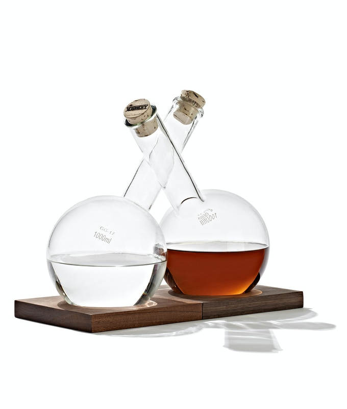 Decanters pictured with walnut (darker) and mahogany bases (available as Cuttink limited run).