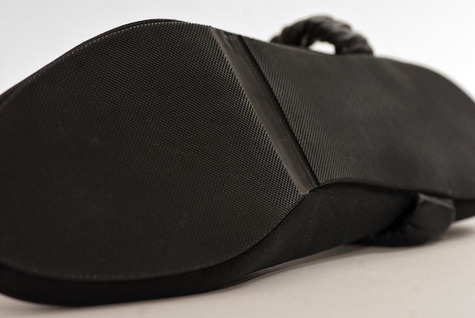 Full rubber outsole with a skived mid-section.
