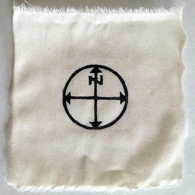 """Compass"", Linoleum hand-printed muslin patch, 5 x 5 inches, Oil-based ink"