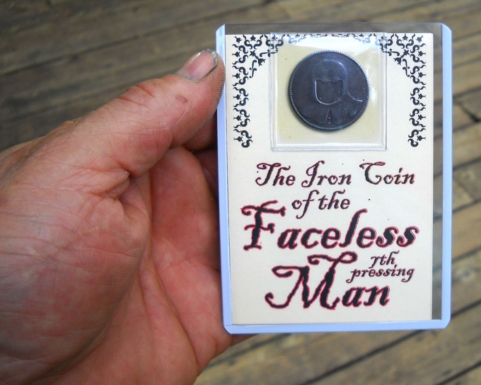 Faceless Man in hard plastic sleeve with printed insert