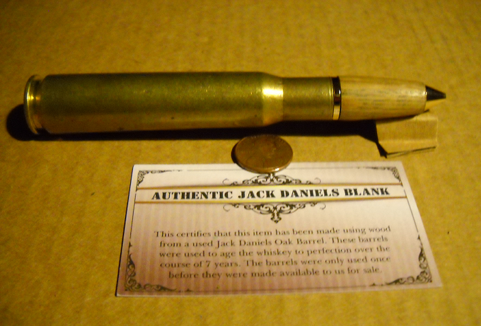 50 Caliber Bullet Tiwst Pen with Jack Daniel's Wood and a Smooth Polished Finish