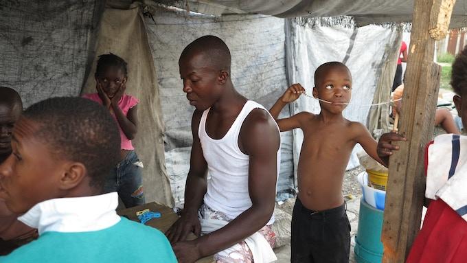 Earthquake victims living in Sou Piste refugee camp, Port-au-Prince, Haiti