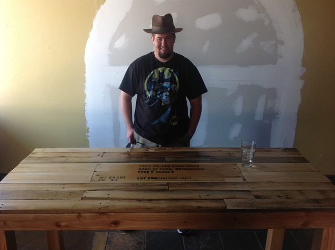 Tables made from reclaimed wood and old ammo crates