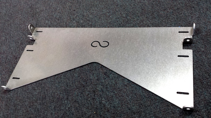 """Mounting plate material test in 1/8"""" alum. Slots on 16"""" centers. We suggest always mounting into studs, hardware will be provided. We have tested weights to 70lbs when mounted to studs with no problem."""