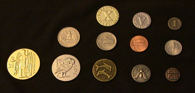Our doubloons, next to modern U.S. currency, next to our Ancient Greek set