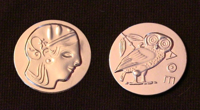 """The """"Athena"""" (quantity 5). A bust of the patron goddess of Athens, along with her iconic owl. This is the exemplar coin of antiquity."""