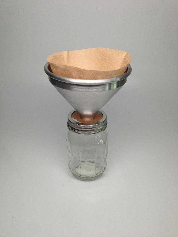 Prototype 2.0: Aluminum funnel with cardboard base.