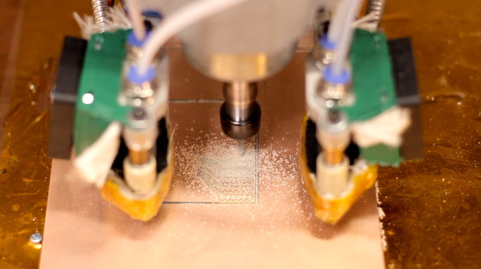 Microfactory etching a circuit board