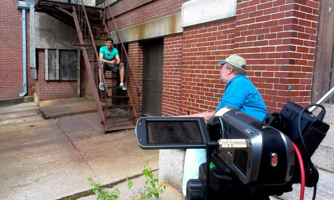 Scott interviewing a student who was there on the last day - on the fire escape of the school