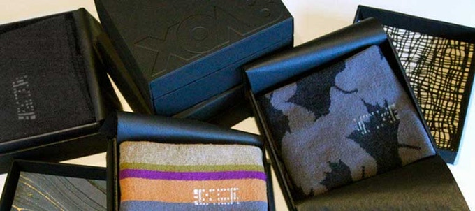 Box lids are lined with a variety of hand-made papers.