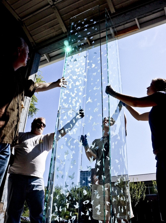 """Lifting the four 10' etched glass pieces into place for a visual test. """"The Structure of Love Is Indestructible,"""" Image © Ross Matteson, 2013"""