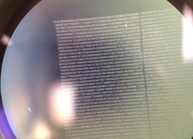 #nanojemspiproject million digit crystal engraving seen through low power microscope