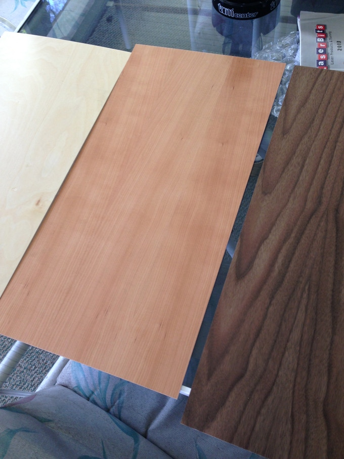 """The first step in the process was ordering .125"""" thickness material to create protypes. I purchased 3 different fiberboard wood laminate sheets. Birch, Cherrywood, and Walnut."""