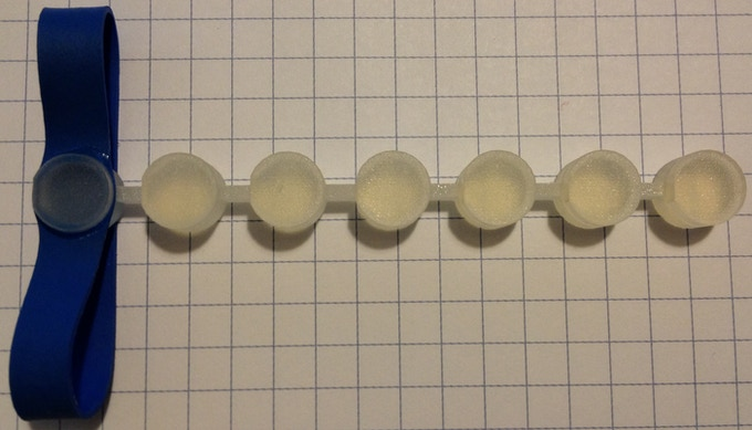 A 3D printed test fixture to test different groove designs.