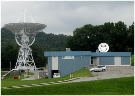 A view of the Research Building which houses APDA on the PARI campus.  The large radio dish and smaller one with the Smiley face are a few of the radio telescopes available on campus.