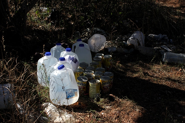 A cache of food and water left by the Samaritans on a migratory trail in southern Arizona.