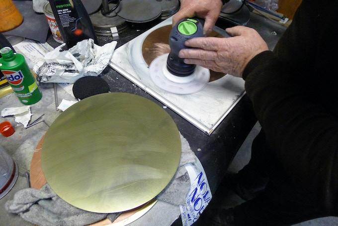 Hand polishing the mirrors.