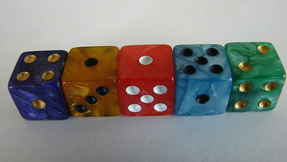 Close up of iridescent CUBIST dice. Red is the Museum Cornerstone