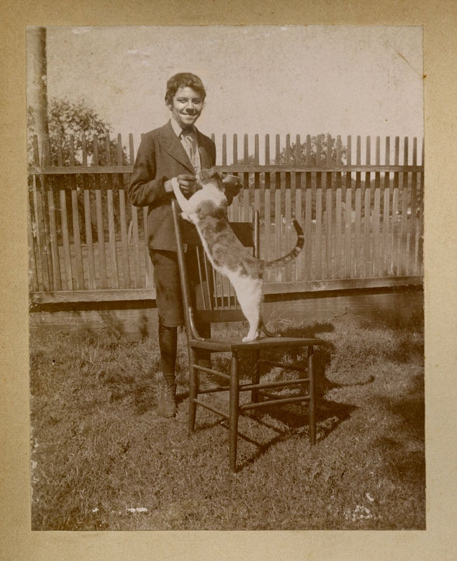 """Photo of James Alexander, 14 years old, and """"Pawsworth,"""" 1898."""