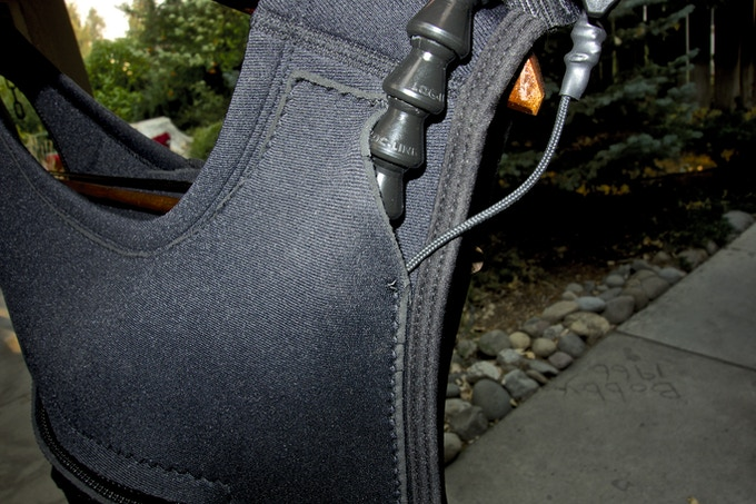 Mechanism for integrating the camera post with the vest for a more snug and rigid fit