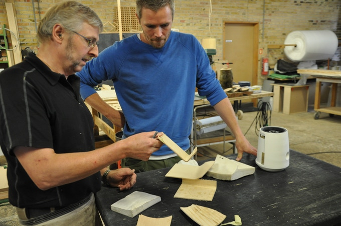 Lars discussing the molded wood wing details with the cabinetmaker