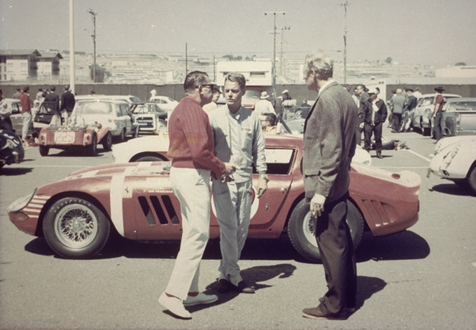 Pre-race strategy session: Bev Spencer (red sweater) and Augie Pabst review race strategy on the pre-grid at Candlestick Park 1964. The Series 2 Ferrari 250 GTO had arrived days earlier by plane from Reims, France.
