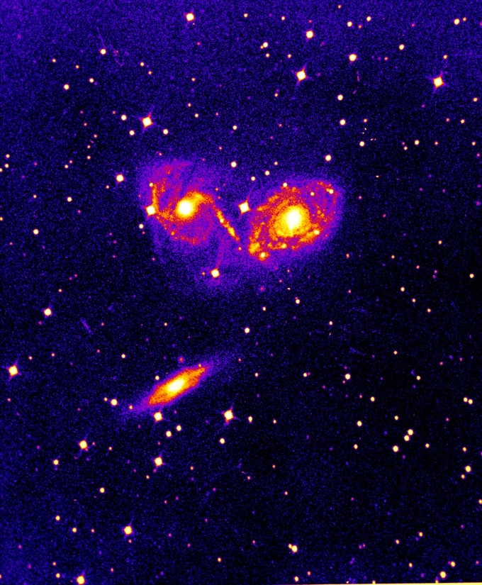 Photographic plate image of the colliding galaxies NGC 6769, 6770, and 6771. These galaxies are located 190 million light years away.  The photograph was taken September 21, 1954 using the 74-inch telescope at Radcliffe Observatory.