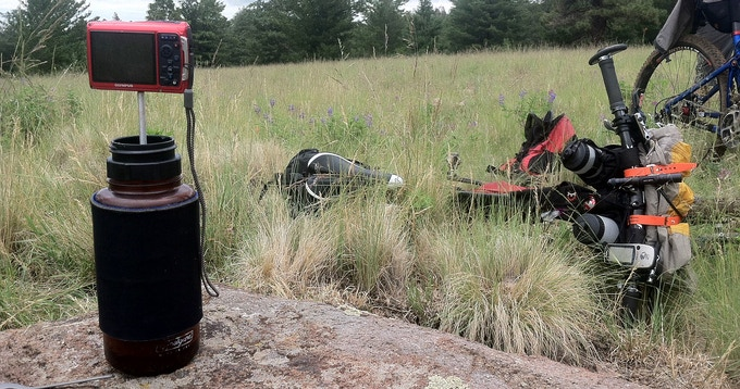 Unscrew the top-cap and the Press-Bot doubles as a caffeinated camera stand. Photographed during a bikepacking trip.
