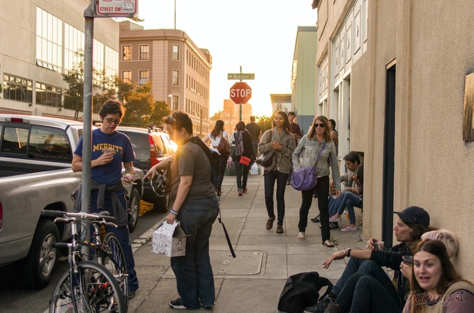 A lot of happy eaters finding a place to sit on 24th Street during one of our food events