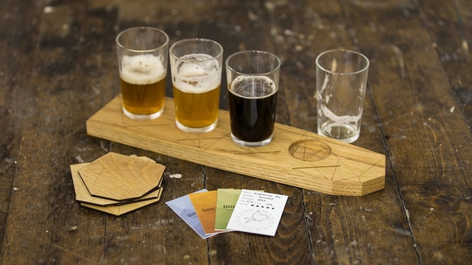 Beer paddle and glasses, coasters, and tasting cards.