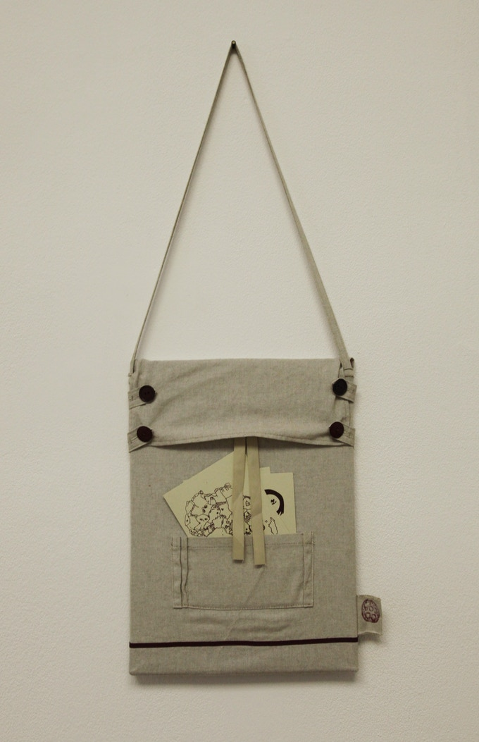 Original handmade bag with postcards in the pocked