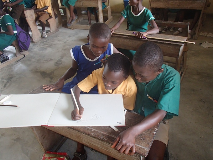 Children in the school complete content of the book, Anyinatiase, Ghana