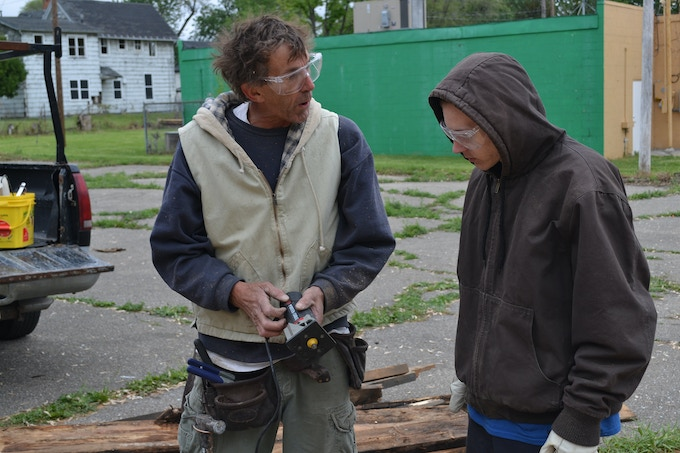 Tim, our local carpenter, apprentices one of our youth-builders.