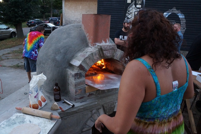 Lekha fires handcrafted pizzas for a crowd of 200 at Spencer's first public event.