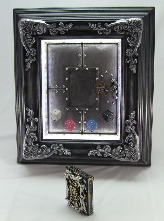 The Mechanical Card Frame shown with optional Amber Rix and Dale Mathis metal Dice.
