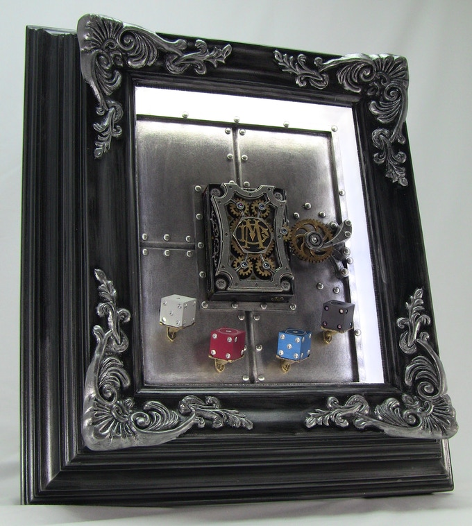 The Mechanical Card Frame with 3D deck and optional Amber Rix & Dale Mathis Dice inserted.