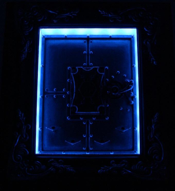 Optional dramatic mood lighting for the Mechanical Card Frame.