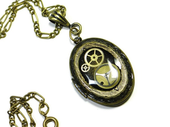 """From Dr. Brassy: """"Let's push this baby over the top! As an added BONUS, everyone who Pledges at my reward level ($115.00) gets not only the Dr Brassy Official League of STEAM Thumbs Up Pin (In brass and glass) but also a Dr Brassy Clockworx Locket Necklac"""