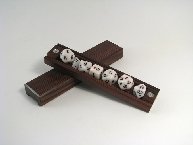 Rosewood vault with Mother of Pearl dice set.