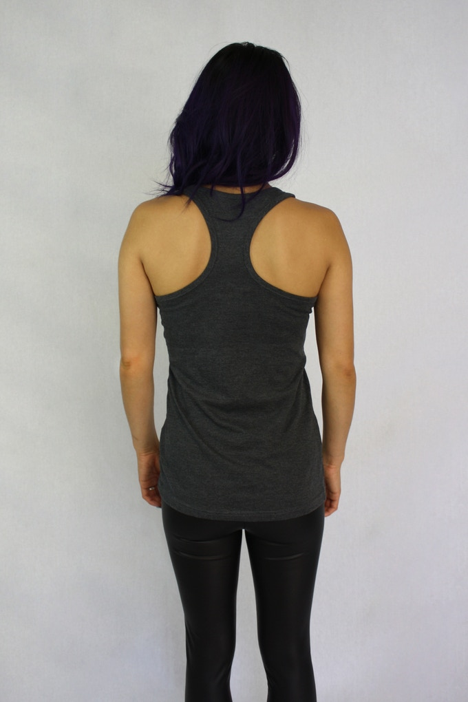 Hi low hem. Oversized arm openings. Soft light weight fabric.